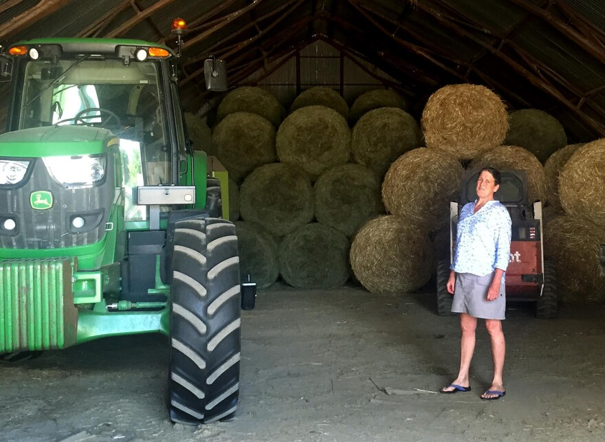 Edie Griffiths stands in the hay barn, where her husband David was injured, on the Seven Stars Farm in Kimberton, Pennsylvania. (Robin Young/Here & Now)