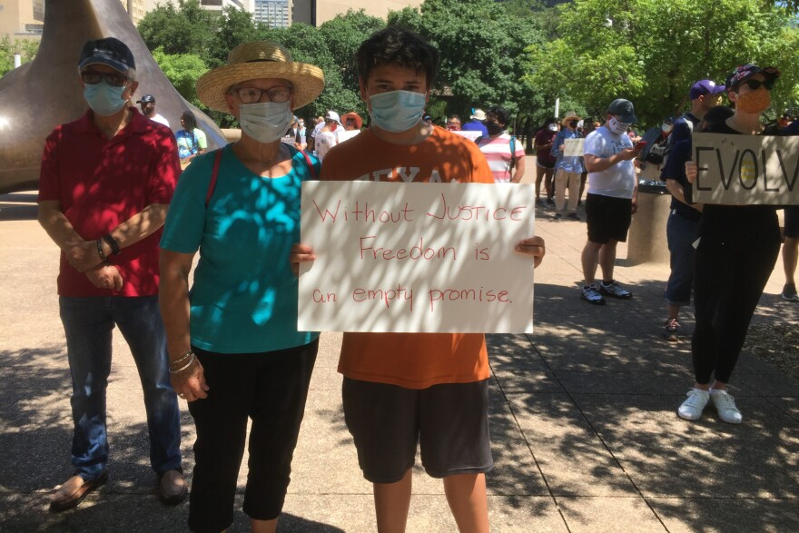 Logan Garcia, a 7th grader from Coppell, came to the protest with his grandmother, Regina Hunt.