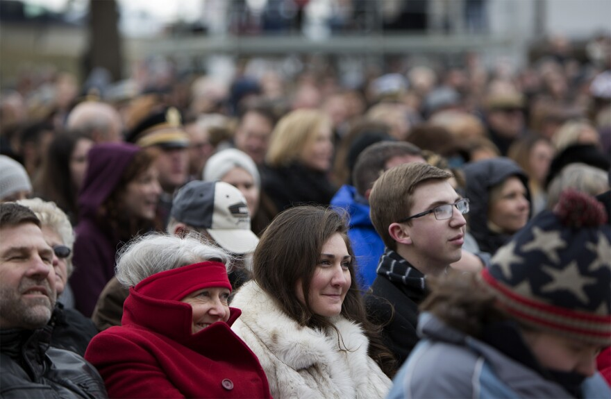 Supporters watch the inaugural ceremony outside the Missouri State Capitol. (Jan. 9, 2017)