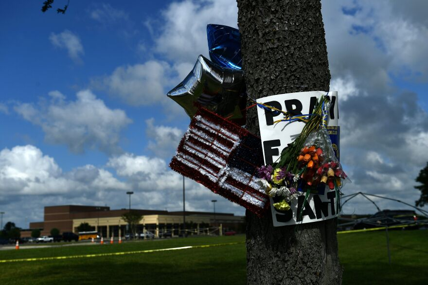 Memorial items hang on a tree near Santa Fe High School in Santa Fe, Texas, a day after eight students and two teachers were killed when a 17-year-old classmate allegedly opened fire at the school.