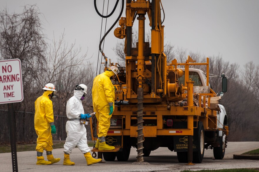 Contractors for Ameren take soil samples from the parking lot of the Gateway school complex on March 28 before doing work to remove a substation in the former Pruitt-Igoe site. The test found no contamination.