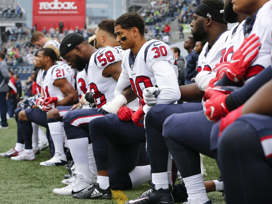 Members of the Houston Texans kneel during the national anthem before the game at CenturyLink Field on Oct. 29, 2017 in Seattle.
