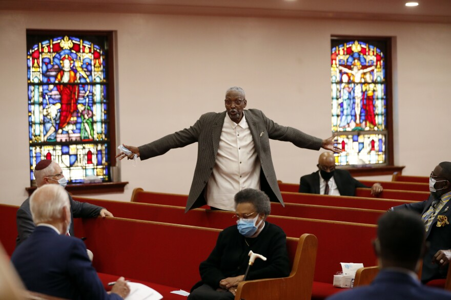 Bishop Thomas Wesley Weeks speaks to Biden on Monday at Bethel AME Church in Wilmington.