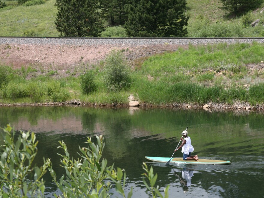 Gary Jackson's wife, Regina, paddleboarding on Pactolus Lake in Lincoln Hills.