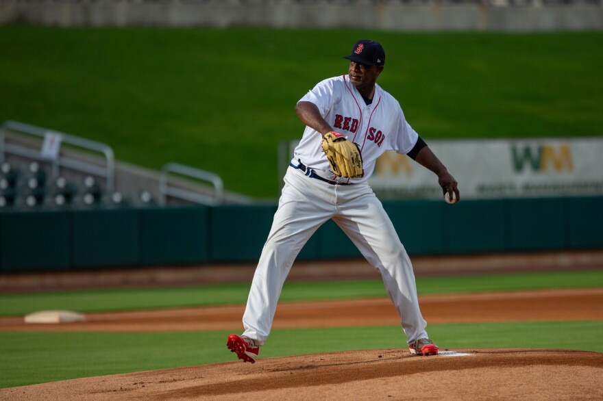 Jimmy Williams, 54, winds up to deliver a pitch during a recent game in Birmingham, Ala. Williams played 18 years in the minor leagues and is happy to be pitching again at a professional ballpark.