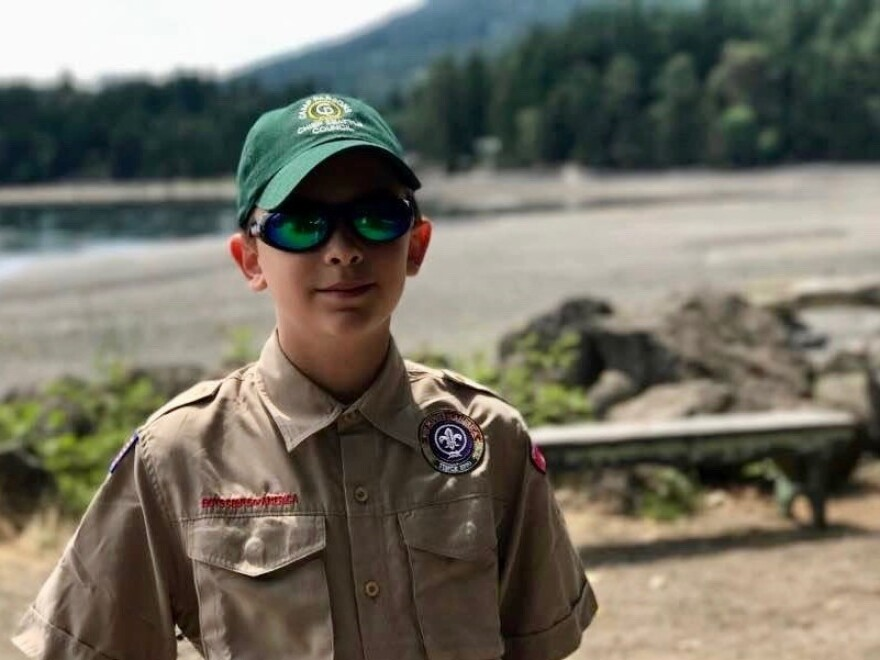"""Boy Scout Charlie Underdown of Seattle says that welcoming girls into the group fits with the Scout Law, which says to be """"trustworthy, loyal, helpful, friendly, courteous, kind, obedient, cheerful, thrifty, brave, clean and reverent."""""""