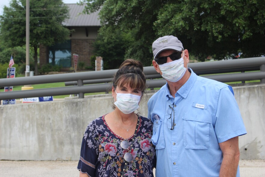 Couple, wearing masks, pictured after voting in Fort Worth.