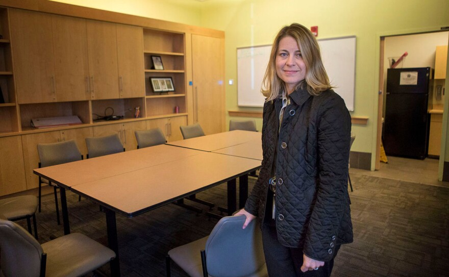 Dr. Jessie Gaeta, chief medical officer of Health Care for the Homeless at Boston Medical Center, stands in a conference room that will soon be converted to a place where patients high on heroin or other drugs can be safely monitored.