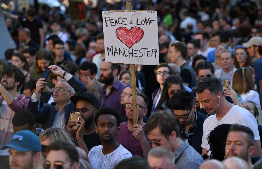 People attend a vigil in Albert Square in Manchester, after the city in northwest England absorbed the worst terror attack on U.K. soil since 2005.