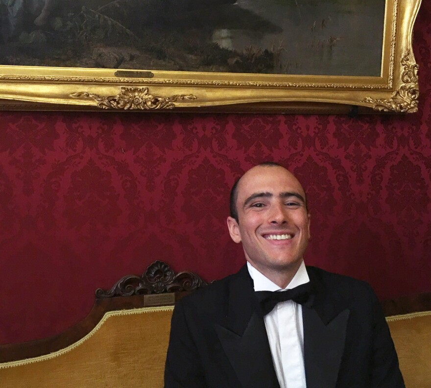 Caffé Greco maitre d' Simone Rampone sits on Hans Christian Andersen's couch.