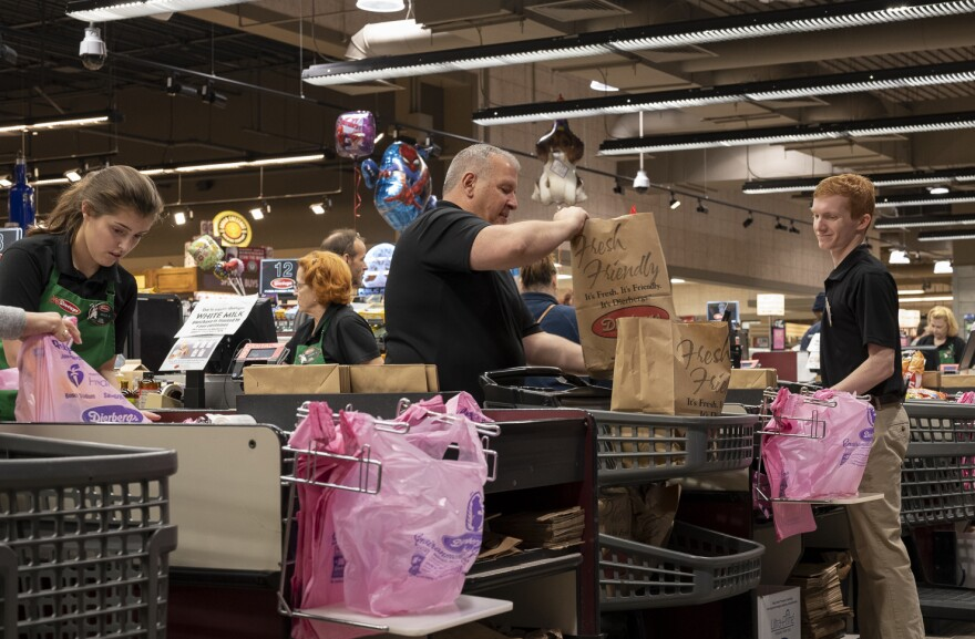 Employees at Dierbergs in Ballwin bag customer groceries on March 21, 2020. Local grocery stores have been particularly busy in recent weeks, as shoppers rush to stock up on essentials during the COVID-19 pandemic.