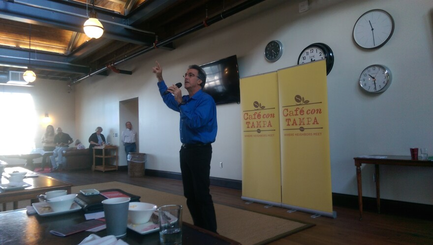 Climate scientist David Hastings warned about the effects of sea level rise on Tampa Bay at Cafe Con Tampa on Friday.