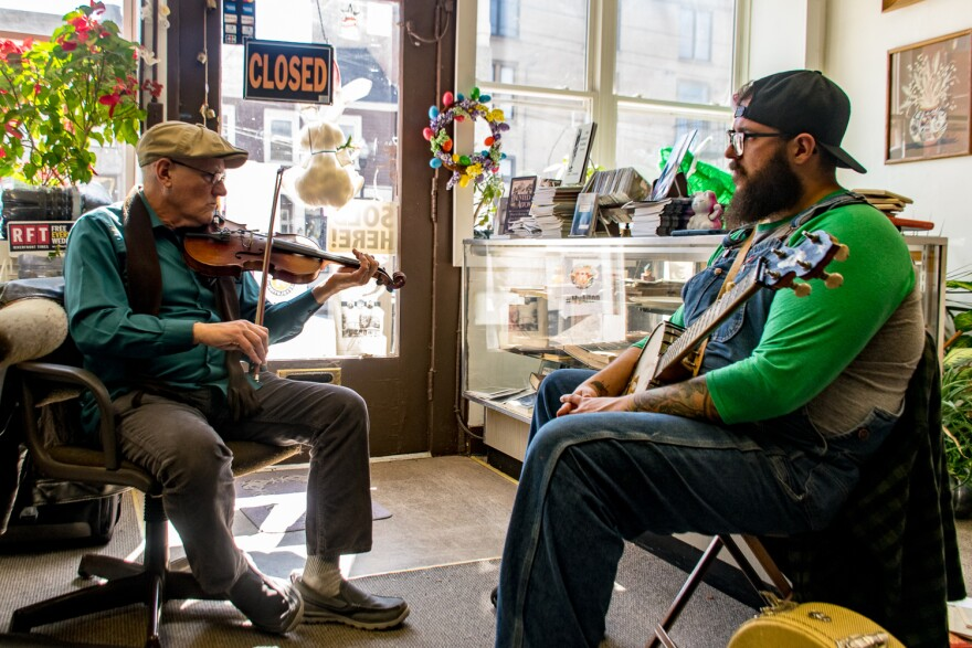 On a chilly Wednesday morning, Wayne Schell (left) and Rory Morse improvise while practicing in The Second Reading Book Shop. March 21, 2018.