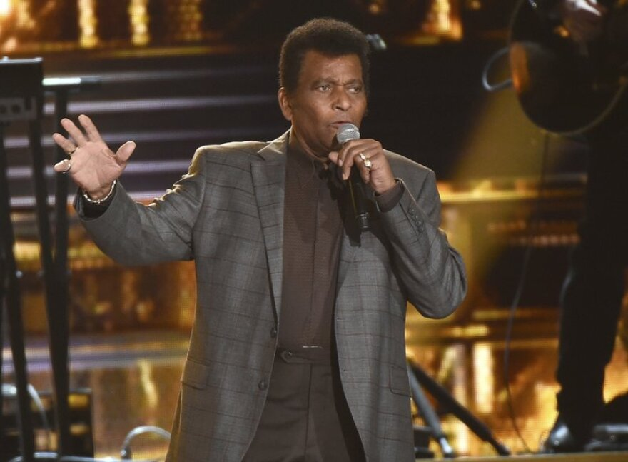 Charley Pride performs on stage in 2016.