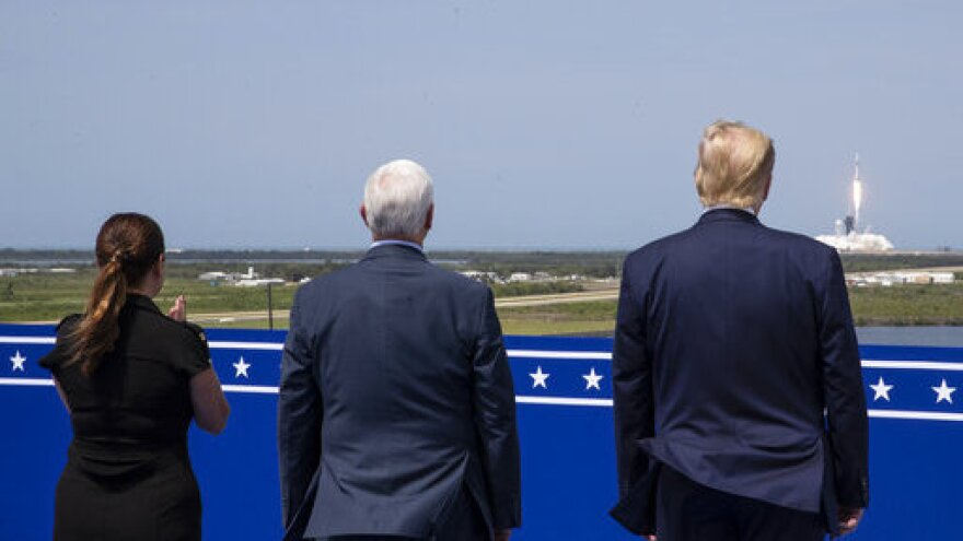 President Donald Trump, right, Vice President Mike Pence, and Karen Pence view the SpaceX flight to the International Space Station, at Kennedy Space Center, Saturday, May 30, 2020, in Cape Canaveral, Fla. (AP Photo/Alex Brandon)