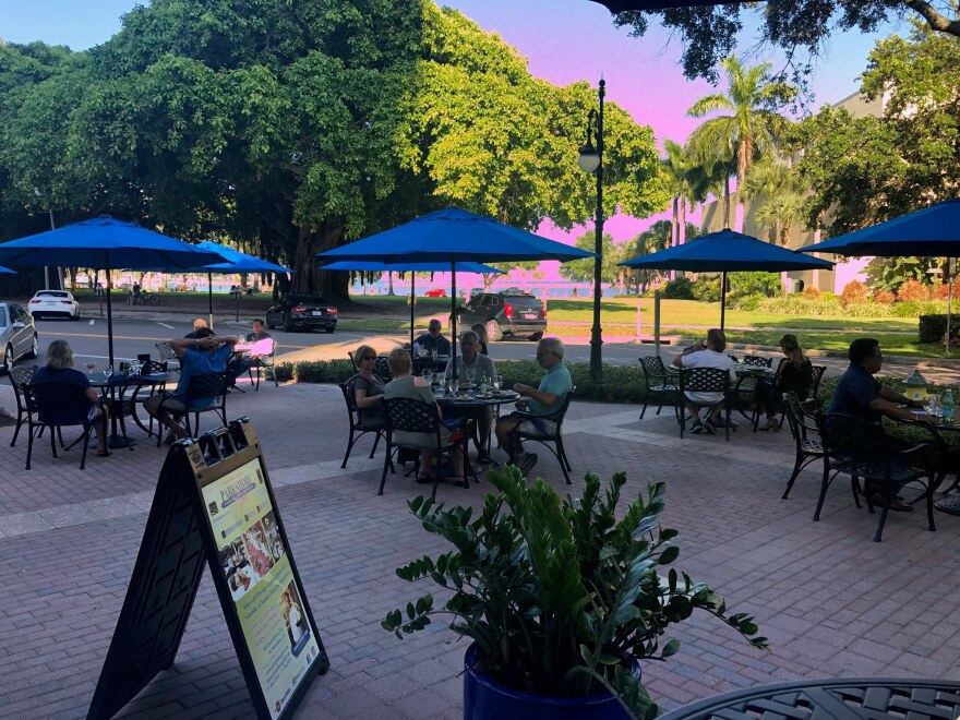 Diners enjoy outdoor seating at Parkshore Grill in St. Petersburg on Monday. Tables must be spaced six feet apart.