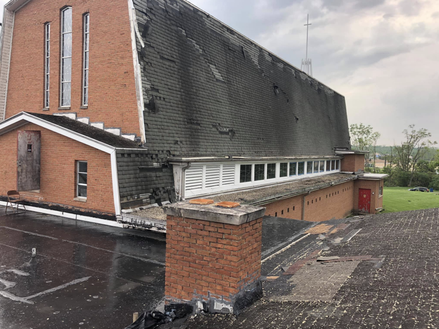 Tornado damage to the exterior of the church building.