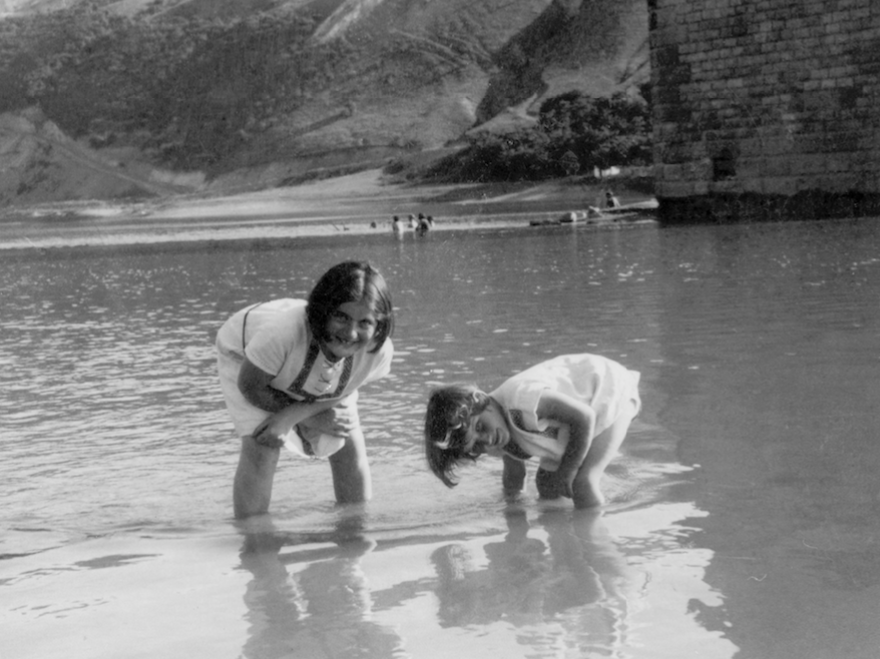 Renia Spiegel (left) and her younger sister, now known as Elizabeth Bellak, wade in the Dniester River around 1935. The photo can be seen on the cover of the published edition of <em>Renia's Diary.</em>
