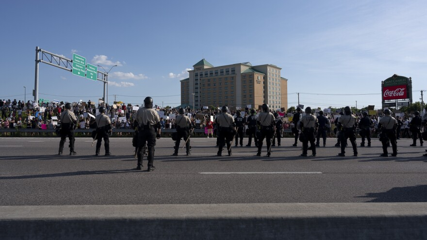 Police block protesters from getting on Interstate 70 in St. Charles on Saturday June 6.