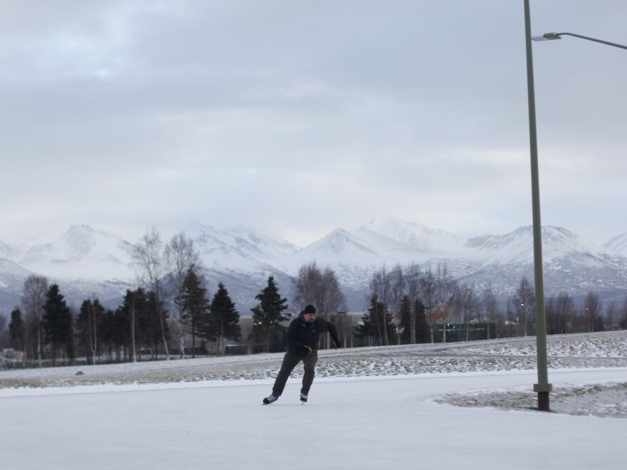 John Blees skates around a speedskating loop in Anchorage. Sports that require less snow, like ice skating and fat-tire bicycling, have become increasingly popular in the city as its climate changes.