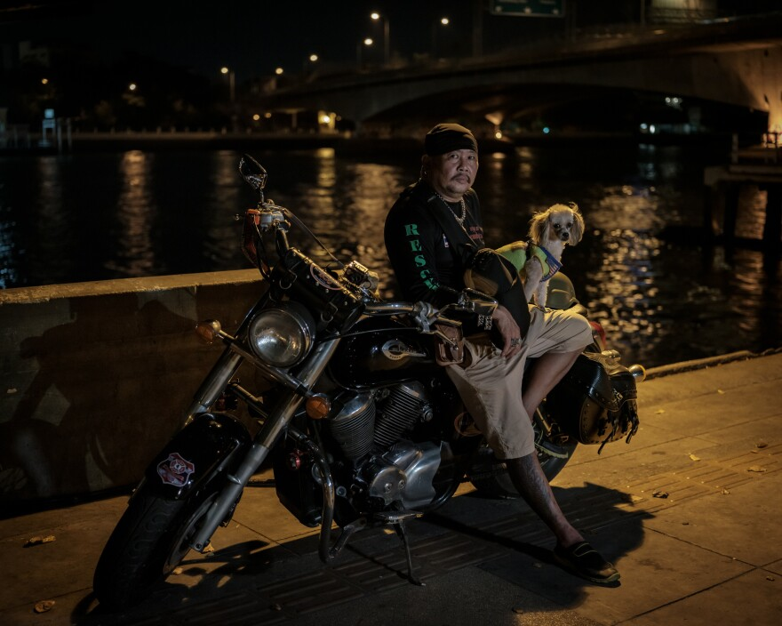 Suchart Prasomsu, 53, leads a rescue team of 30 volunteers in Bangkok, using his motorcycle to get to car crashes and crime scenes. Since the start of the pandemic, they've also been called on to try and keep people from killing themselves.