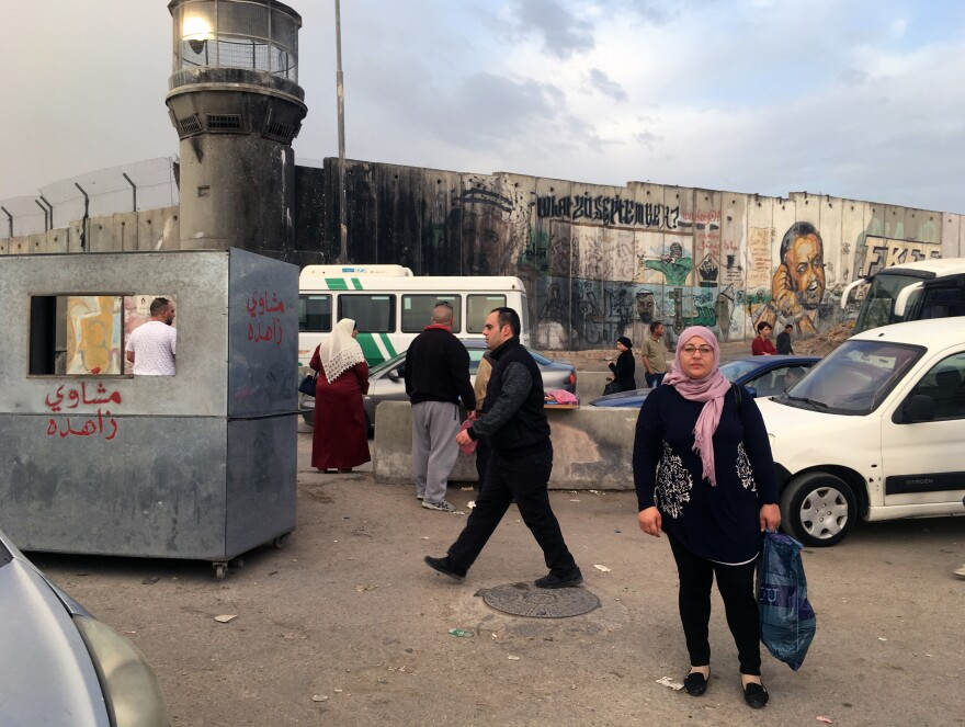 Raja Tamimi must cross the Qalandia checkpoint to commute to her job in Jerusalem's Old City.