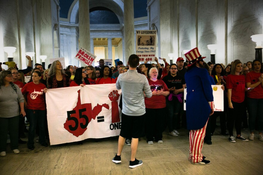Teachers and other state workers rally at the Capitol, Mar. 6, 2018.