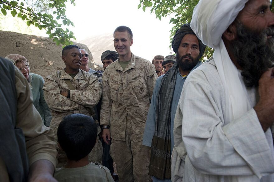Maj. Jason Brezler holds a meeting with local governors in 2010 in Afghanistan's Helmand province.
