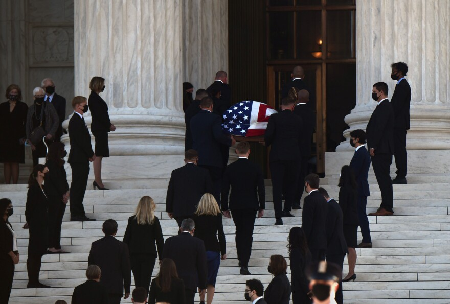 Justice Ruth Bader Ginsburg's casket is carried into the Supreme Court in Washington, D.C., on Wednesday.