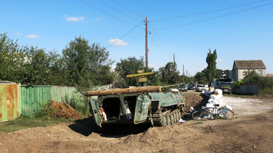 Ukrainian soldiers tied thick logs to this armored personnel carrier and in lieu of winches and other equipment to pull the vehicle out of the mud.