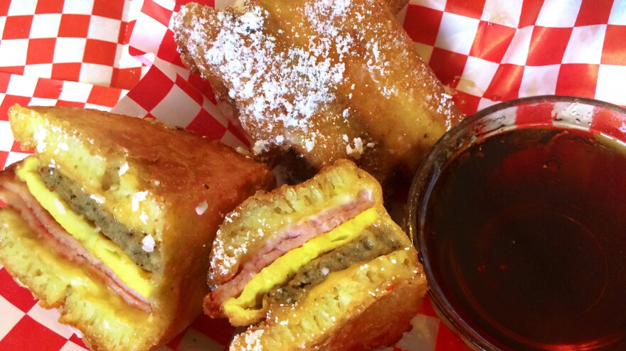 Deep-fried breakfast on-a-stick is a new food at this year's Minnesota State Fair. It contains American and Swiss cheeses, a sausage patty, one egg and Canadian bacon sandwiched between two pancakes, then dipped in a light, sweet batter and deep-fried on a stick.