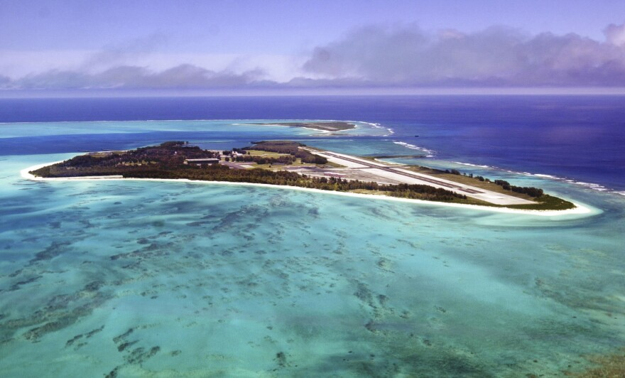 Waves crash on the shores of Midway Atoll in the Papahānaumokuākea National Monument.