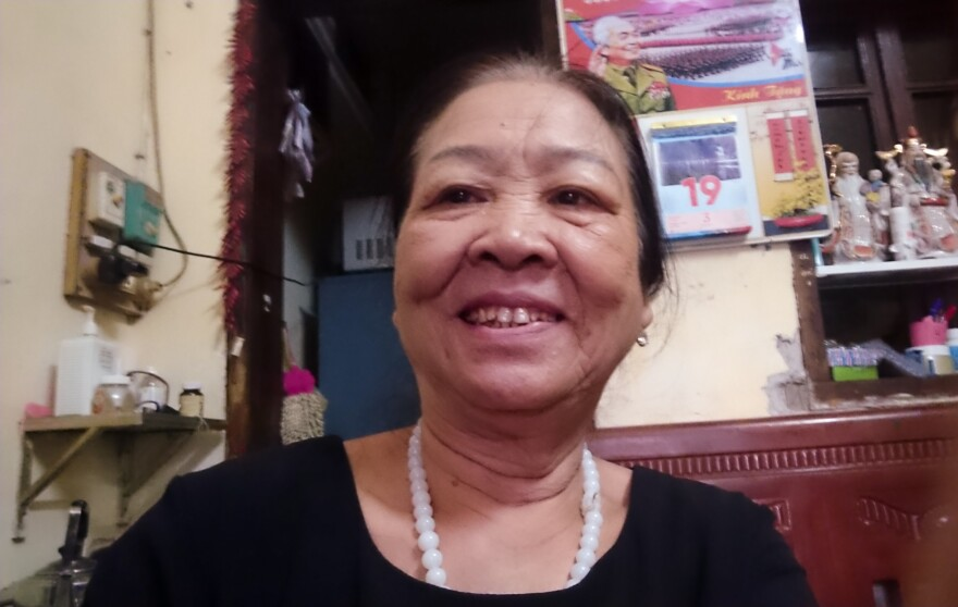 Dao Thi Hoa, 69, takes a selfie. Since she retired, she's been volunteering as the head of the Intergenerational Self Help Club in the Khuong Din ward of Hanoi.