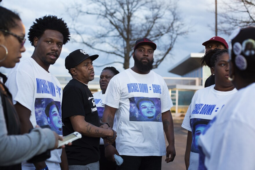 Michael Brown Sr. and organizers with his Chosen for Change Foundation talk outside the Ferguson Community Center after the City Council's vote to approve the terms of the Department of Justice's consent decree.