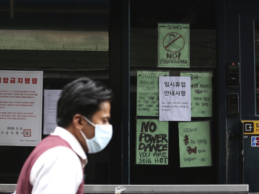 South Korea reported 34 new infections on Sunday, its highest daily tally in about a month. Most of the new infections were tied to several bars and nightclubs in Seoul.
