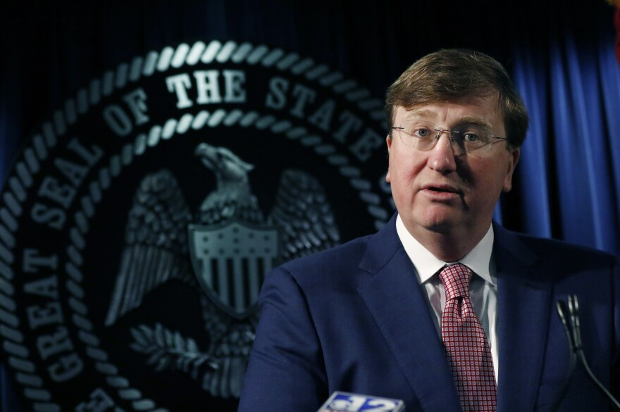 Republican Gov. Tate Reeves speaks with reporters on a variety of issues, including the state prison system, on Feb. 6. in Jackson, Miss.