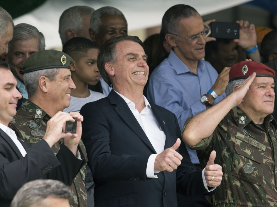 Brazil's then-President-elect Jair Bolsonaro (center) and Gen. Walter Braga Netto (second from left) smile during a ceremony marking the 73rd anniversary of the Brazilian Paratrooper Infantry Brigade in Rio de Janeiro, Brazil, on Nov. 24, 2018.