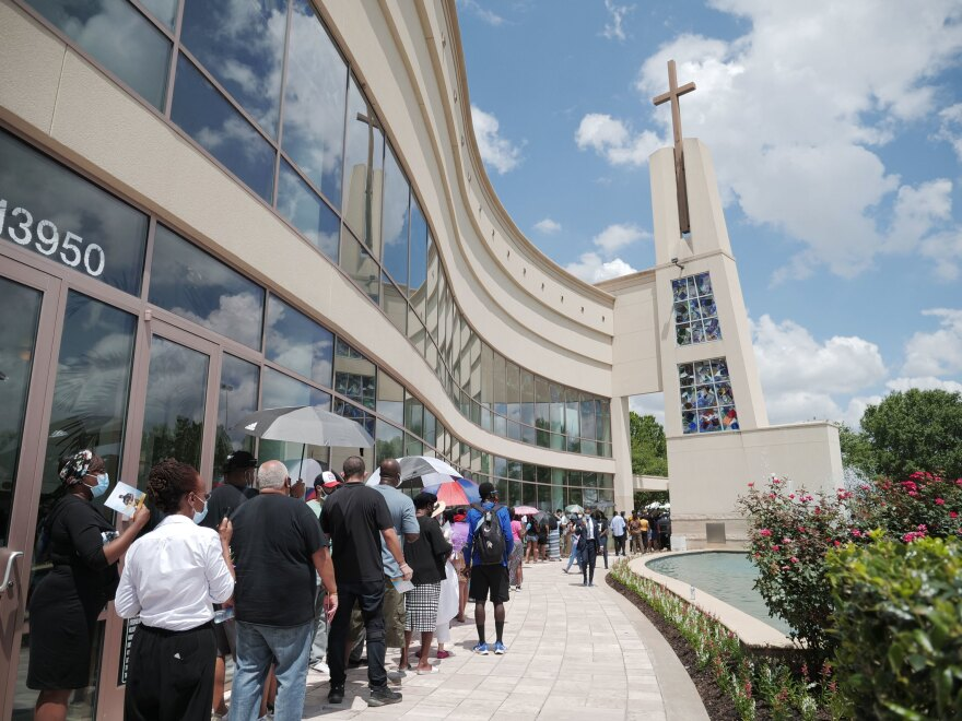 Mourners attend Floyd's memorial Monday at The Fountain of Praise church in Houston.