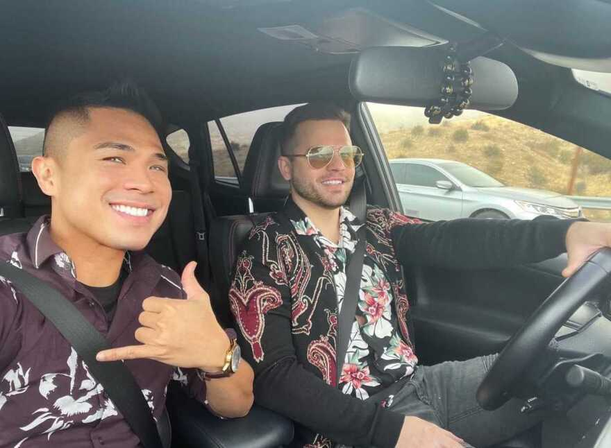 Airbnb host Jino Cabrera, left, and his partner, Scott Carnwath, on their way to Las Vegas after making nearly $15,000 from Airbnb's public stock market debut.