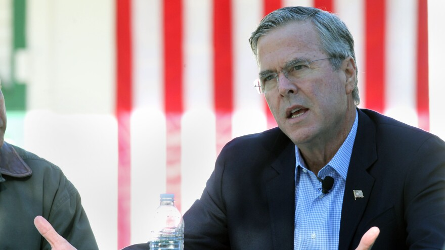Republican presidential hopeful Jeb Bush is slashing staff salaries and making other deep cuts to keep his presidential hopes alive.