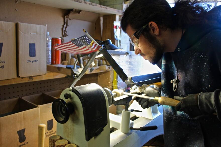 Joshua Smith shapes the bowl for a corn cob pipe on a lathe at the Missouri Meerschaum Company in Washington, Missouri.