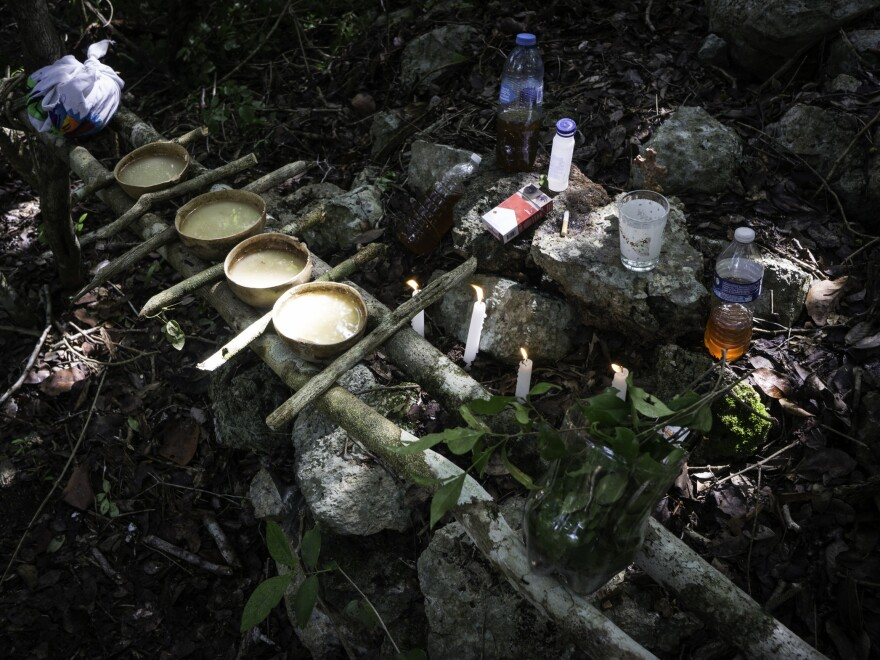 The offering for the guardians of the cave is vast: honey, pozol (a fermented drink with dough), water and tobacco — a modern version with a box of Marlboro cigarettes.