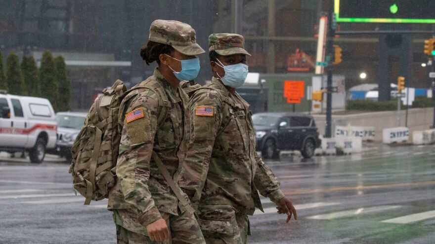 U.S. military personnel, seen outside the overflow hospital at the Javits Convention Center in Manhattan last month. The Pentagon has issued interim guidance advising caution pursuing recruits who have been hospitalized previously with COVID-19.