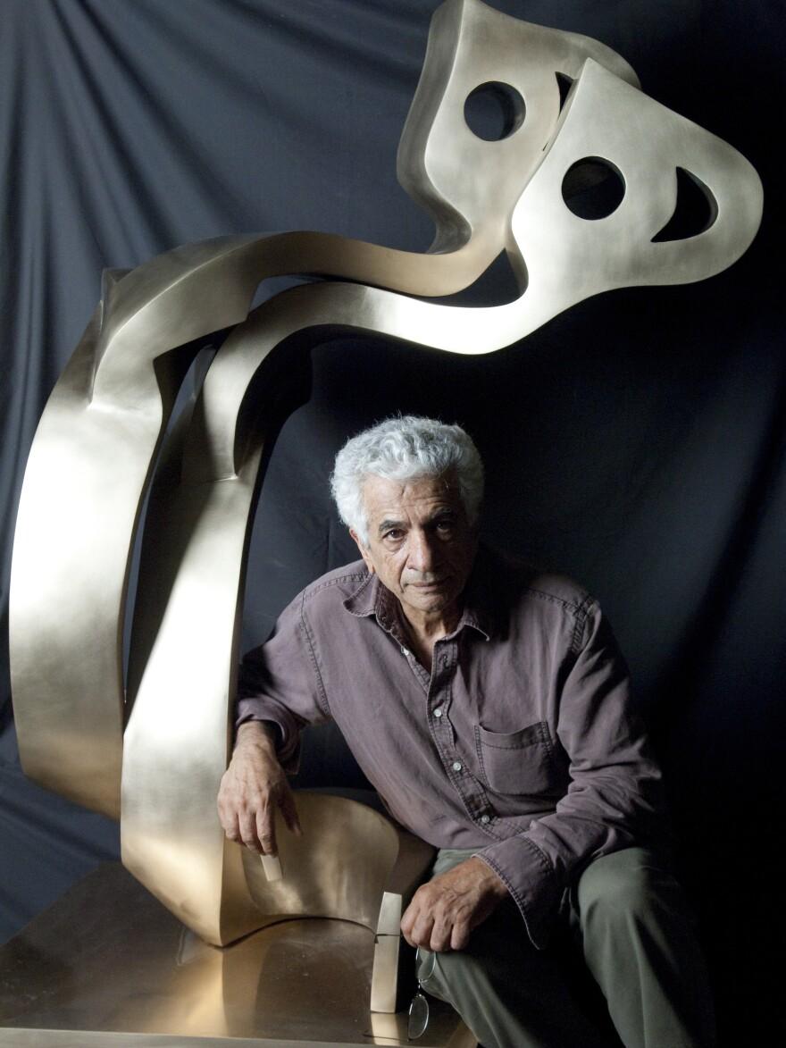 Artist Parviz Tanavoli with his sculpture <em>Big</em> <em>Heech Lovers</em>.
