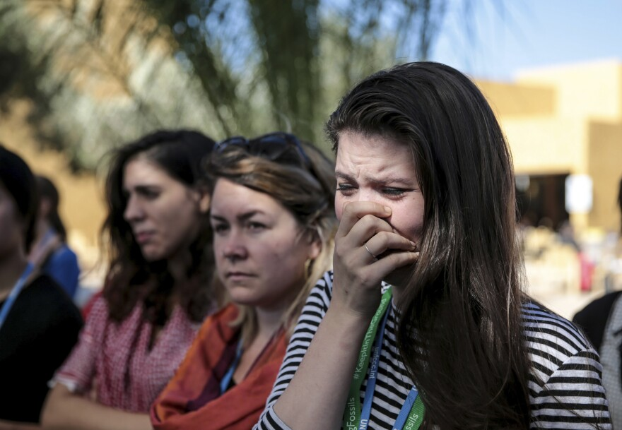 Environmental activist Bethany Hindmarsh, 26, cries during a protest against President-elect Donald Trump at the Marrakech climate conference on Nov. 9.