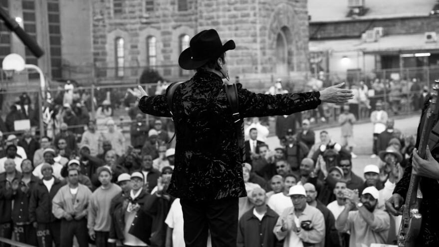 Vocalist and accordion player Jorge Hernández engages the crowd of inmates in the main yard of Folsom State Prison