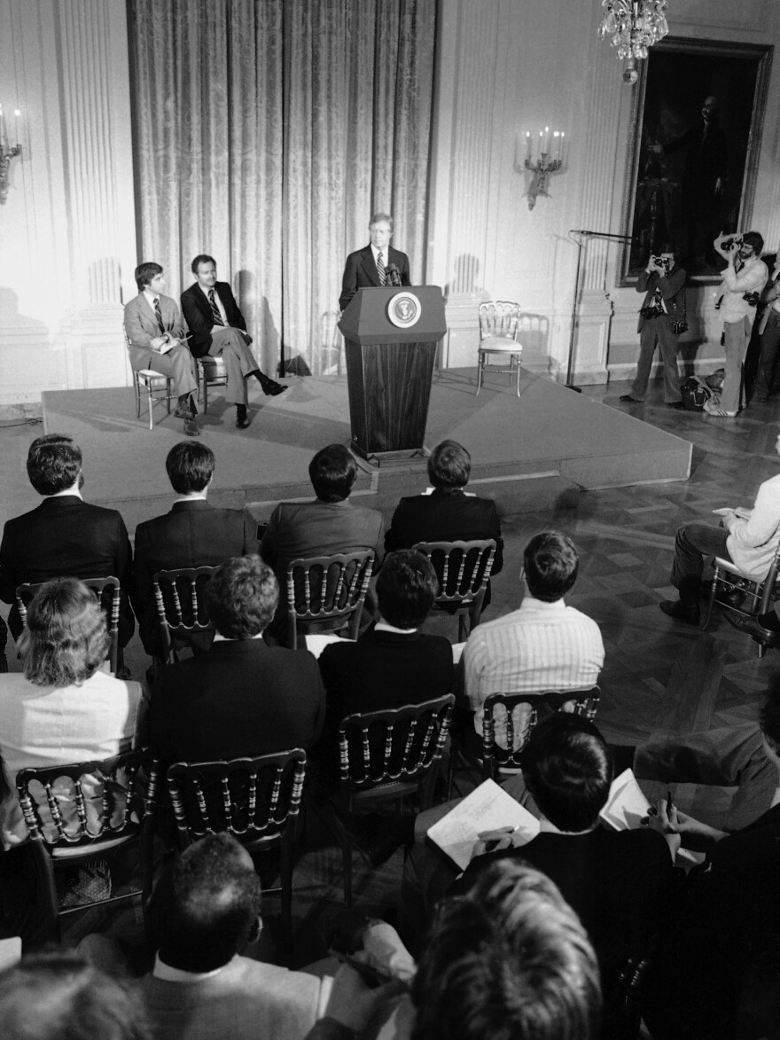 President Jimmy Carter addresses athletes at the White House who were to compete in the Moscow Summer Olympic Games on March 21, 1980. The president asked them to support his proposed boycott of the Games to punish the Soviets for their invasion of Afghanistan.