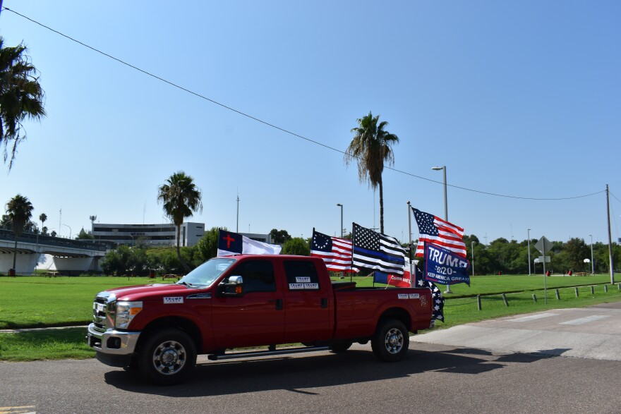 """A caravan of cars drive through Laredo in a """"Trump Train."""" Cars flew American flags and Trump flags in support of the president's campaign for reelection."""