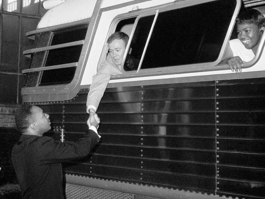 Dr. Martin Luther King Jr., civil rights leader, shakes hands with Paul Dietrich just before a bus of Freedom Riders left Montgomery, Ala., May 24, 1961.