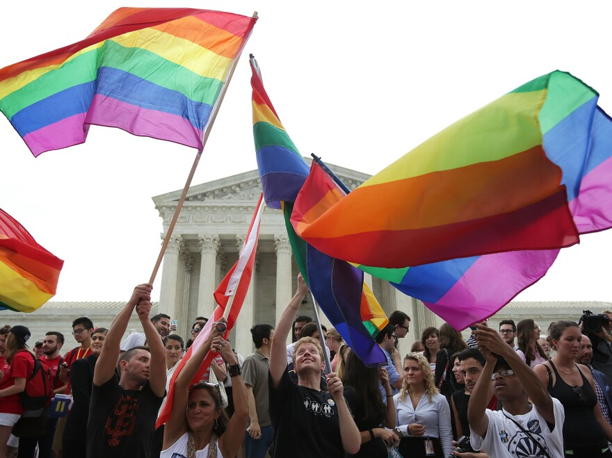 Supporters of same-sex marriage celebrate outside the Supreme Court in Washington, DC., June 26, 2015, after the high court ruled same-sex couples have the right to marry in all 50 states.